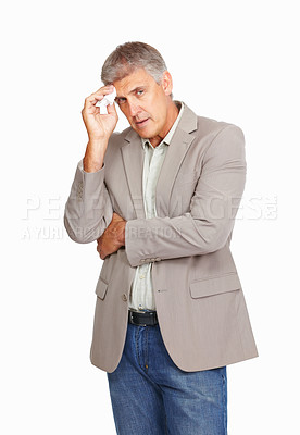 Buy stock photo Studio shot of a mature man wiping the sweat from his forehead against a white background
