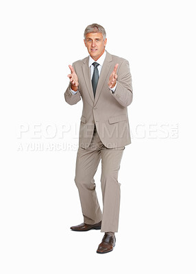 Buy stock photo Full length of mature business man gesturing over white background