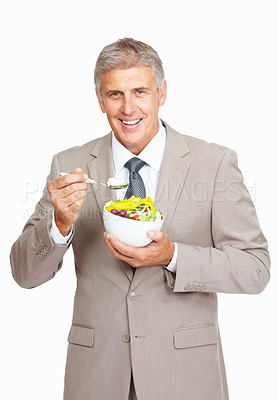 Buy stock photo Studio shot of a mature businessman eating a healthy salad against a white background