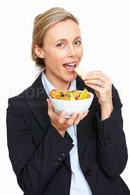 Buy stock photo Portrait of beautiful attractive business woman enjoying fruit salad on white background
