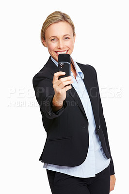 Buy stock photo Portrait of business woman taking photo using her mobile phone on white background