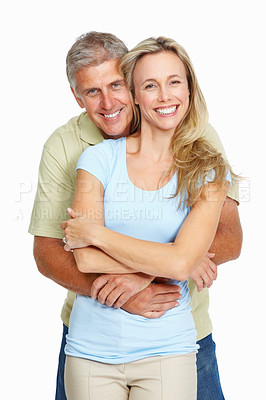 Buy stock photo Portrait of loving man hugging his wife from behind over white background