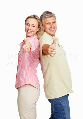 Buy stock photo Portrait of happy mature couple showing thumbs up over white background