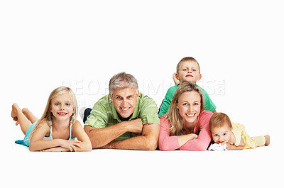 Buy stock photo Portrait of happy family lying together on the floor over white background