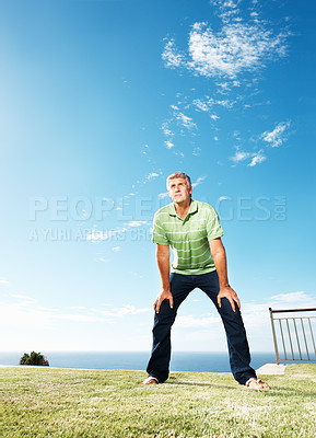 Buy stock photo Full length of handsome mature man at park looking at copyspace and blue sky