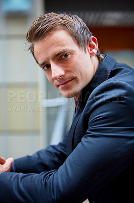 Buy stock photo Young Businessman full of ideas looking at you