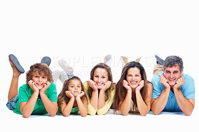 Buy stock photo Mother, father, son and two daughters smiling, lying on the studio floor