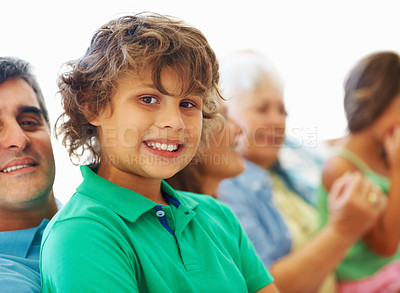 Buy stock photo Closeup portrait of father and son with family sitting in the background