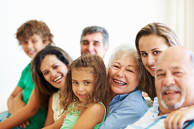 Buy stock photo Family portrait - Cheerful three generation family sitting together on couch