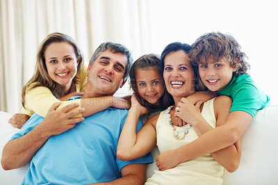 Buy stock photo Happy parents with son and daughters having fun together at home