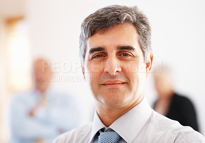 Buy stock photo Closeup of happy business man with colleagues in background