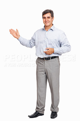 Buy stock photo Full length of happy business man with pointing at copyspace on white background