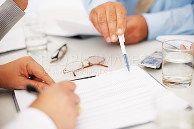 Buy stock photo Closeup of hands with paperwork at business meeting in the office