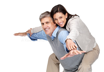 Buy stock photo Portrait of a happy mature couple enjoying themeselves against white background