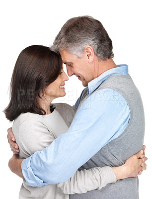 Buy stock photo Portrait of a cute mature couple hugging and looking at each other against white background