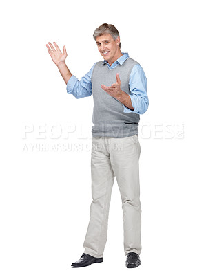 Buy stock photo Portrait of happy mature man gesturing at copyspace against white background