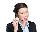 Furious young businesswoman yelling during a phone call