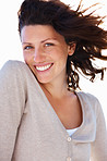Happy young woman enjoying the wind in her hair