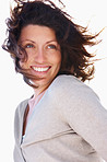 Happy young woman with hair being blown away by wind