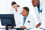 Doctors reviewing medical reports