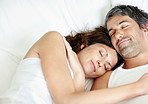 Lovely middle aged couple sleeping together