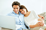 Modern lifestyle - Happy young couple using laptop at home