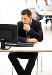 Young business man working on computer in office