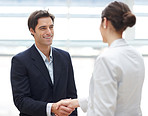 Successful young business executives shaking hands with eachother