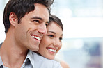 Closeup of a happy young couple looking at copyspace