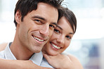 Closeup of a cute young couple together with arms around