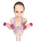 Smiling female with dumbbell standing on a weighing scale
