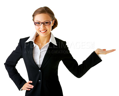 Buy stock photo Portrait of a young businesswoman. with her hand outstretched, as though she is presenting something.