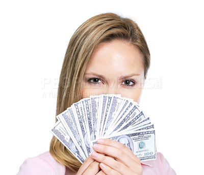 Buy stock photo Young female holding a fan of American dollar notes over face against white