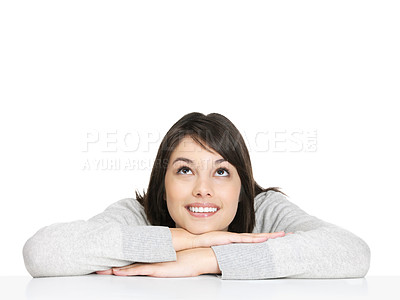 Buy stock photo Young relaxed female sitting at a table and looking upwards at copyspace