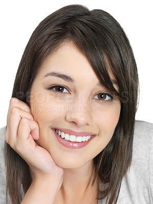 Buy stock photo Closeup portrait of a cute young female smiling against white