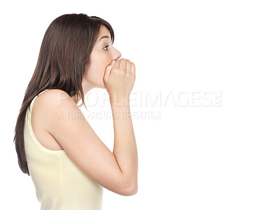 Buy stock photo Side view of a cute young female whispering to someone isolated against white