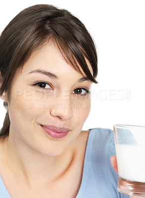 Buy stock photo Closeup of a cute smiling female holding a glass of fresh milk isolated on white