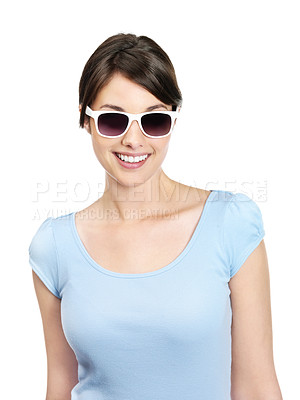 Buy stock photo Portrait of a sweet young female wearing sunglasses isolated against white