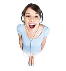 Top view of a young female enjoying music over headphones