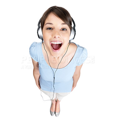 Buy stock photo Top view of a cute young female listening to music over headphones