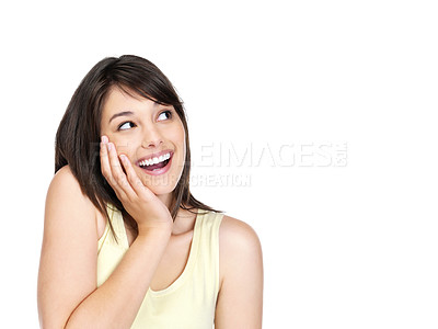 Buy stock photo Portrait of a surprised young woman looking at something interesting against white background