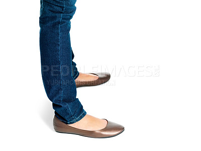 Buy stock photo Lower section - Legs of a young woman standing on white background
