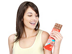 Beautiful young lady holding a chocolate
