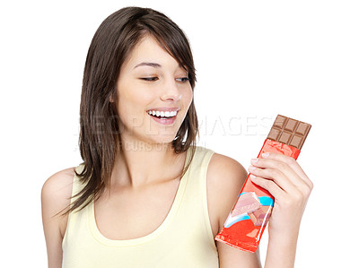 Buy stock photo Portrait of a beautiful young lady holding a chocolate against white background
