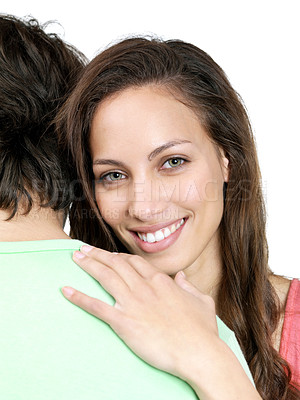 Buy stock photo Portrait of a beautiful young female hugging her boyfriend on white background