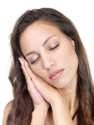 Buy stock photo Closeup of a beautiful young woman sleeping on hand on white background