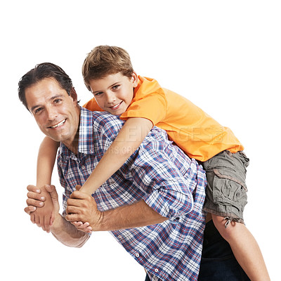 Buy stock photo Potrait of a happy young father giving piggyback ride to his son against white background