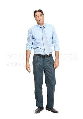 Buy stock photo Shot of a businessman looking surprised while standing against a white background