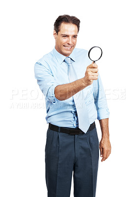 Buy stock photo Studio shot of a businessman holding a magnifying glass against a white background