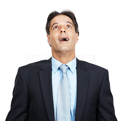 Buy stock photo Studio shot of a businessman looking up at copyspace with a surprised facial expression